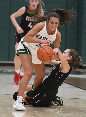 GlenOak's Lexi Kleptach steals the ball from New Philadelphia's Audrey Harr in the first half of Tuesday's game.