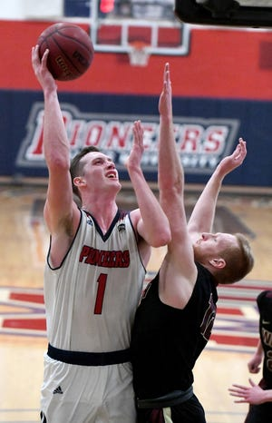 Malone's Marcus Ernst puts up a shot with pressure from Walsh's Caleb Canter during last week's game at Malone.