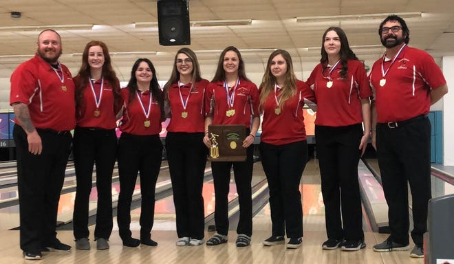 The Sandy Valley High School girls bowling team poses for a photo after winning a 2021 district championship to advance to the state tournament for the first time in program history. Pictured are (from left to right) coach Joe Boyer, Joey Boyer, Lilly Shepler, Sarah Deford, Hannah Deford, Raven Cordia, Miah Delaney, coach Dave Deford. Makenzie McLemore is not pictured.