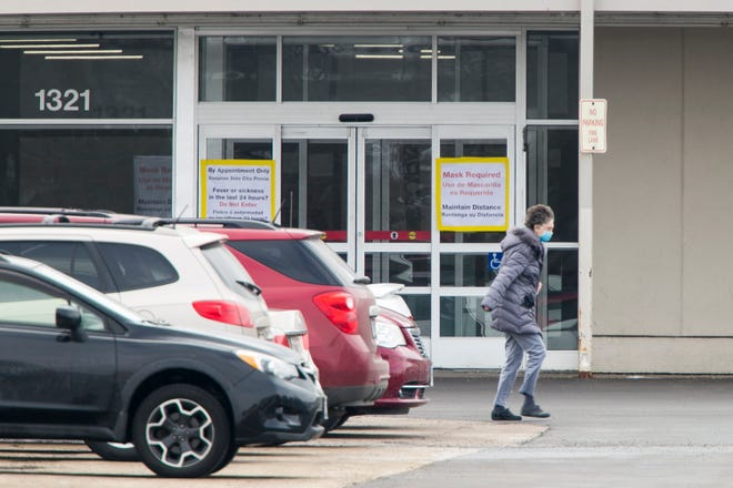 People enter and exit the mass COVID-19 vaccination site at the former KMart on Sandy Hollow Road on Wednesday, Feb. 24, 2021, in Rockford.