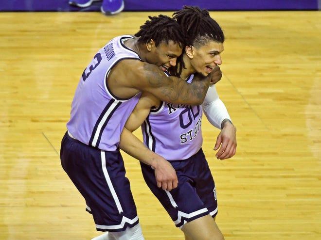 Kansas State's DaJuan Gordon (3) and Mike McGuirl (00) celebrate their 62-57 victory over No. 7-ranked Oklahoma on Tuesday night at Bramlage Coliseum.