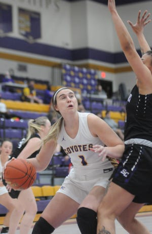 Kansas Wesleyan's Kelcey Hinz (1) looks to score against Southwestern's Sidney Dennis during the first quarter Tuesday night at Mabee Arena.