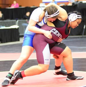 Salina Central's Rebekah Franklin for an escape against Olathe West's Mikayla Rivera during last year's 235-pound state semifinal match at Tony's Pizza Events Center.