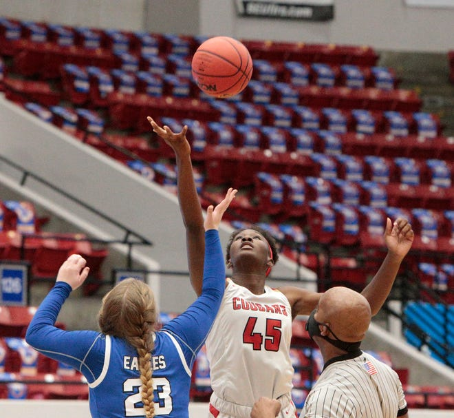 Action between Cardinal Mooney and The Master's Academy in the Class 3A girls basketball state semifinal.