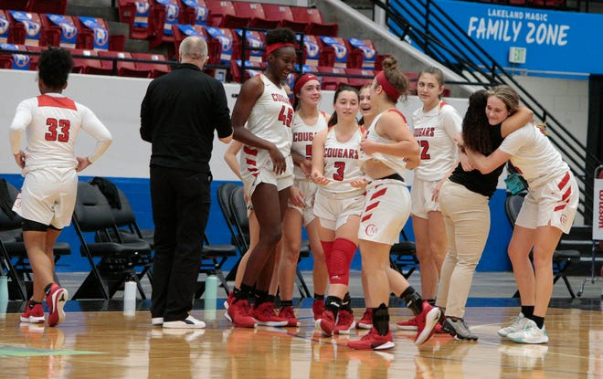 The Cardinal Mooney Catholic girls basketball team celebrates its win over Oviedo The Master's Academy in the Class 3A state semifinal on Feb. 24 in Lakeland. The Cougars will play for the state title 10 a.m. Friday against Miami Country Day at RP Funding Center in Lakeland .