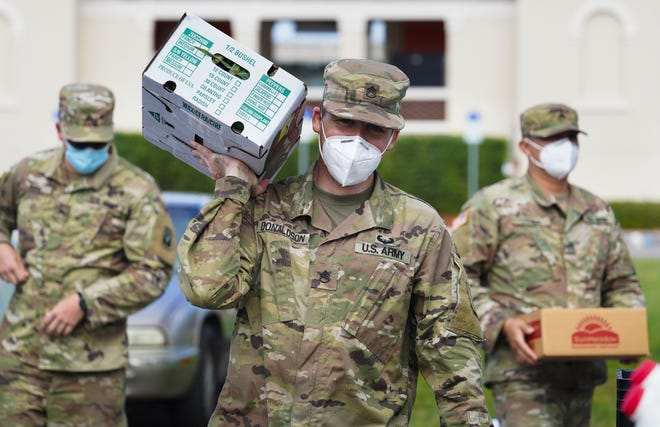 The National Guard assists All Faiths Food Bank with a food distribution at Ed Smith Stadium in Sarasota in May 2020. New College's Garland Hanson is working with All Faiths to study food insecurity among veterans.
