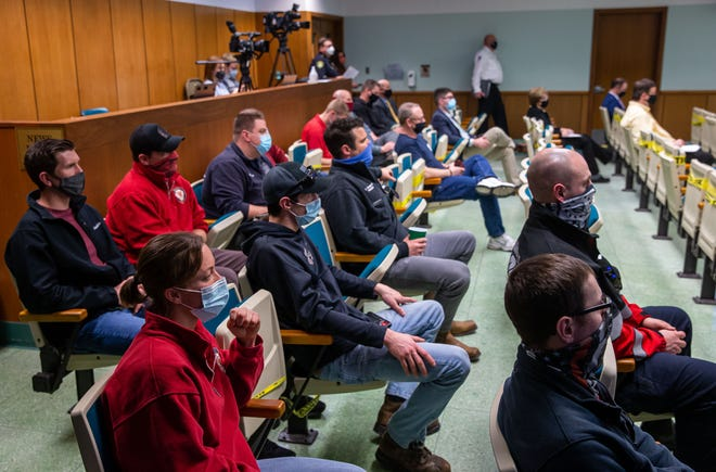 Members of the Springfield Fire Department listen to debate of possible cuts to the budget for the Springfield Fire Department in the City of Springfield's Fiscal Year 2022 budget during a special City Council meeting in the council chambers in Springfield, Ill., Tuesday, February 23, 2021. [Justin L. Fowler/The State Journal-Register]