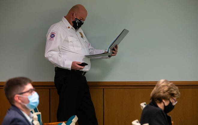 Springfield Fire Chief Brandon Blough looks through documents as he listens to debate for a reduction in funding for the Springfield Fire Department in the City of Springfield's Fiscal Year 2022 budget during a special City Council meeting in the council chambers in Springfield, Ill., Tuesday, February 23, 2021. [Justin L. Fowler/The State Journal-Register]