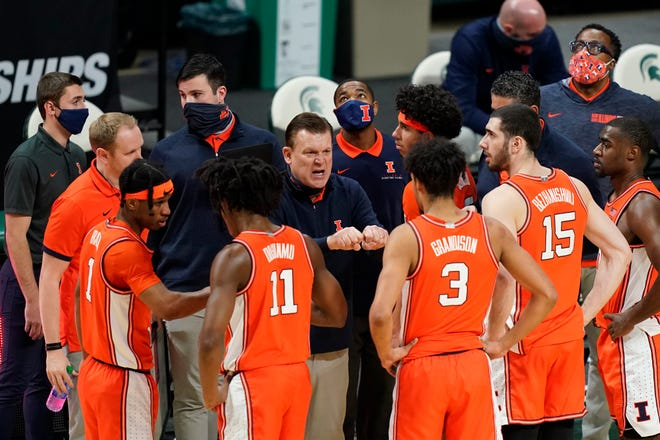 Illinois coach Brad Underwood talks to his team during a timeout in the second half against Michigan State on Tuesday, Feb. 23, 2021, in East Lansing, Mich.