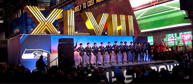 The Radio City Rockettes perform at the unveiling of the Super Bowl XLVIII numbers in 2014. The numbers, produced by Ace Sign Co. of Springfield, are nominated for the Illinois Manufacturers' Association's Makers Madness contest running through March 21.