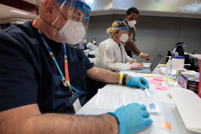 In this Standard-Times file photo, Curative staff prepare for the opening of the mass vaccination site at the former Dartmouth Circuit City.