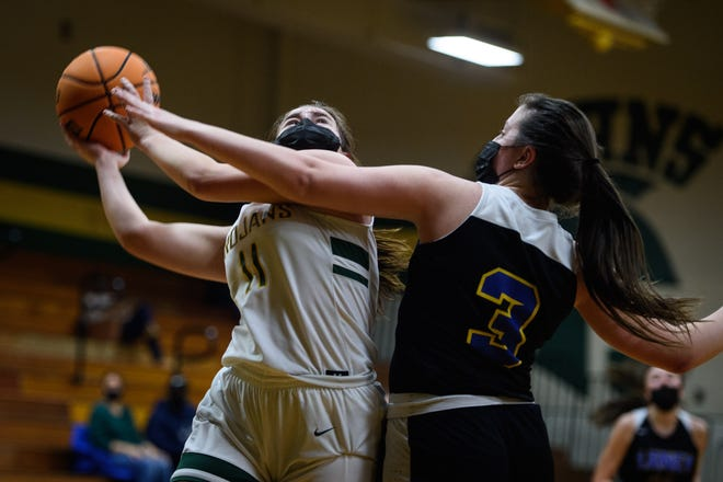 Bouncing back from a shooting drought, Pine Forest sophomore Valerie Veauthier (11) made six 3-pointers and finished with 21 points in the Trojans' first-round playoff win against Laney on Tuesday.