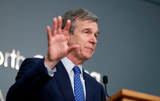 N.C. Gov. Roy Cooper speaks during a briefing at the Emergency Operations Center in Raleigh, N.C., Wednesday, Feb. 24, 2021. (Ethan Hyman/The News & Observer via AP)