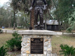 A statue of a Civilian Conservation Corps member at O'Leno State Park near High Springs had 50,000 CCC members who replanted 50,000 acres and built O'Leno and seven other flagship state parks.