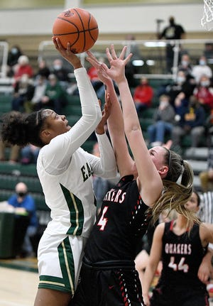 Aniyah Hall of GlenOak  shoots with pressure from Alyssa Miller of New Philadelphia at GlenOak Tuesday, February 23, 2021.