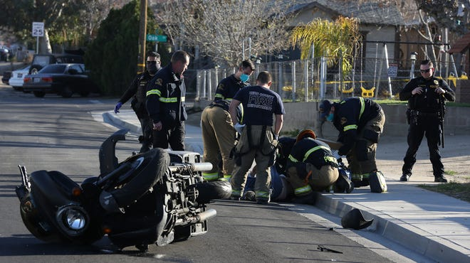 Firefighters treat Taft man injured in motorcycle accident on South Sixth Street Monday afternoon.