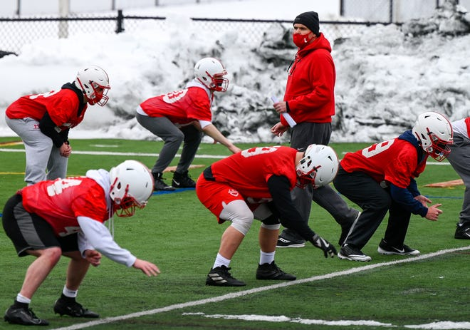 Melrose football coach Tim Morris watches a football practice session closely at Fred Green Memorial Field on Tuesday, Feb. 23. His Red Raiders are anxious to get the Fall II season underway, and it will finally commence on Saturday vs. host Woburn at 1:30 p.m.