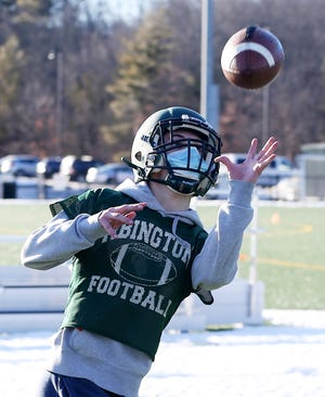 Abington High's Brendan O'Brien works on one handed catches from out of the backfield during football practice at the high school on Wednesday, Feb. 24, 2021.