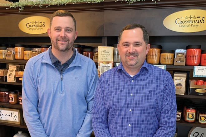 Justin, left, and Jason McMullen, entrepreneurs and owners of Crossroads Candles.