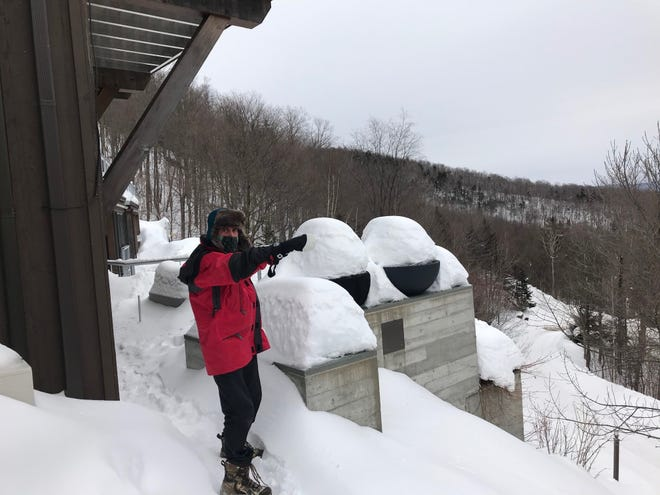 Mike Krancer points to another neighboring house from his perch atop Bull Moose Ridge Road in Stowe. As seen on Feb. 18, 2021.