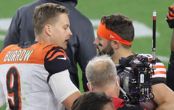 Joe Burrow and Baker Mayfield chat after their meeting last September.