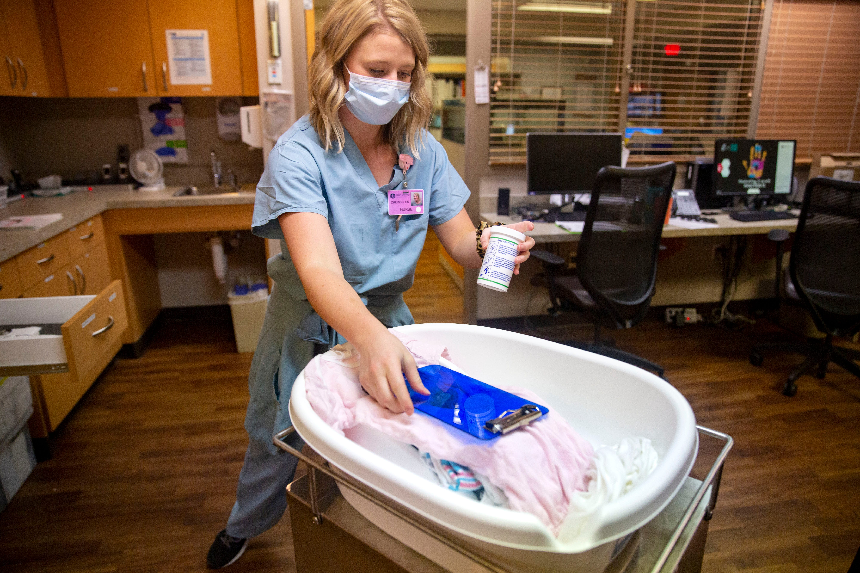 Birthways nurse Cherish Shuka prepares to give a newborn a bath at Mary Greeley Medical Center on Feb. 17.