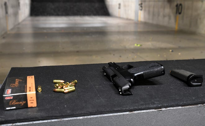 A pistol waits for a shooter during a conceal carry training session the National African American Gun Association held at Crossroads Shooting Sports on Feb. 20.
