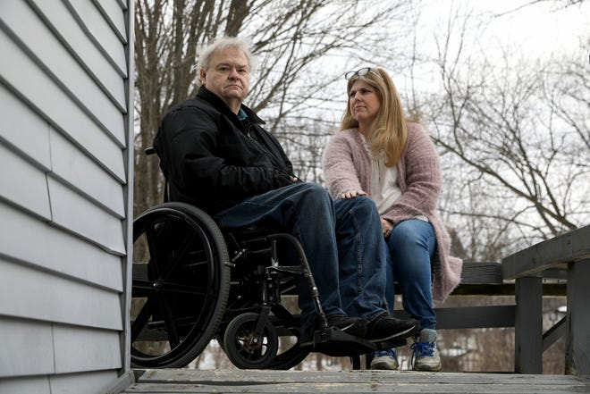 (L to R) David and Jodi Schumaker at their Independence Township, Michigan home on Wednesday, February 24, 2021, the day after a long ordeal and drive to find a COIVD-19 vaccine for David. It was a trip that took them on a 14 hour drive to Laurel, Mississippi.