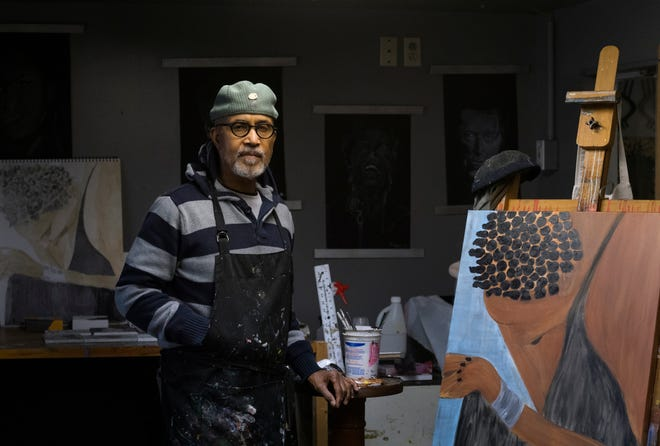 Artist Billy Twymon poses in his studio at the Twymon Art Gallery Friday afternoon, Feb. 12, 2021. Twymon said he opened his own gallery where artists from all walks of life were welcome to express themselves.