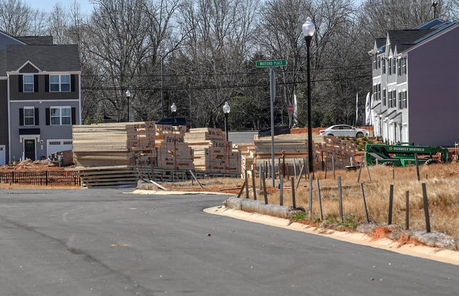 With prefabricated sections in stacks for construction workers to piece together in a timely fashion, the growth of Easley housing can be seen also at Edgewood Townehomes. The Ryan Homes development off of State Highway 8 in Easley which advertises homes starting from the $150,000 in February 2021.