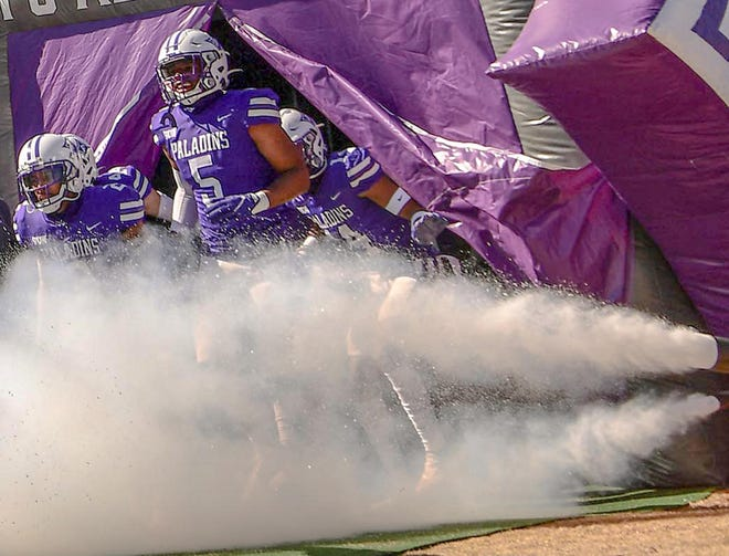 Furman linebacker Dae'one Wilkins(5) enters the field before the game at Paladin Stadium in Greenville, S.C. Saturday, February  20, 2021.