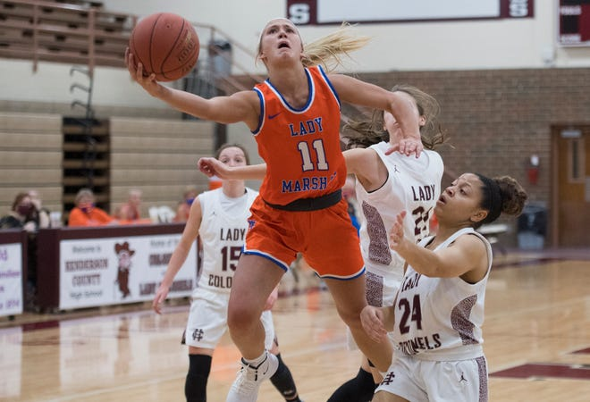 Marshall County's Cayson Conner (11) takes a shot as the Marshall County Lady Marshals play the Henderson County Lady Colonels in Henderson, Ky., Tuesday evening, Feb. 23, 2021.