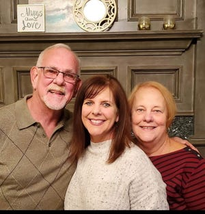 Joe and Donna Cougill with their daughter, Laura Mabry (center), who the Cougills say is responsible for reuniting them, leading to their marriage.