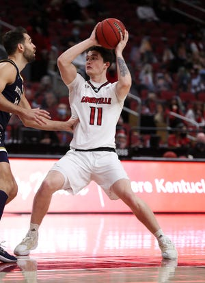Louisville's Quinn Slazinski (11) looked to pass against Notre Dame at the KFC Yum! Center in Louisville, Ky. on Feb. 23, 2021.