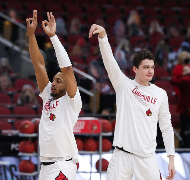 Louisville's Carlik Jones (1) and Quinn Slazinski (11) as they warmed up for Notre Dame at the KFC Yum! Center in Louisville, Ky. on Feb. 23, 2021.
