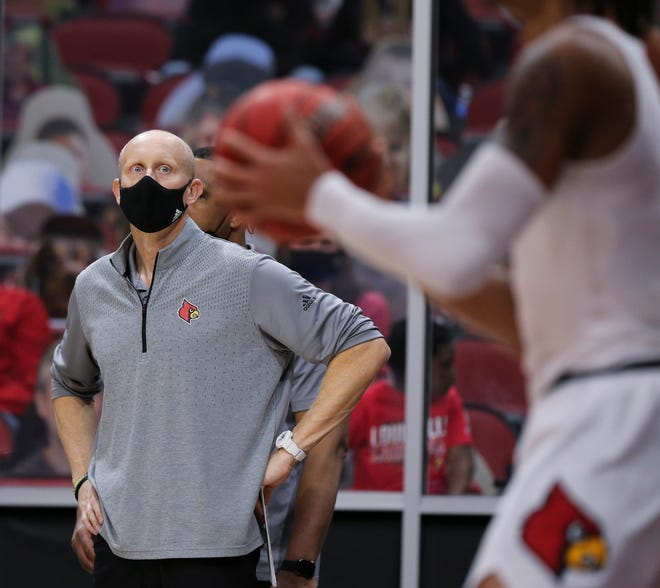 Louisville head coach Chris Mack watched his team inbound the ball against Notre Dame at the KFC Yum! Center in Louisville, Ky. on Feb. 23, 2021.