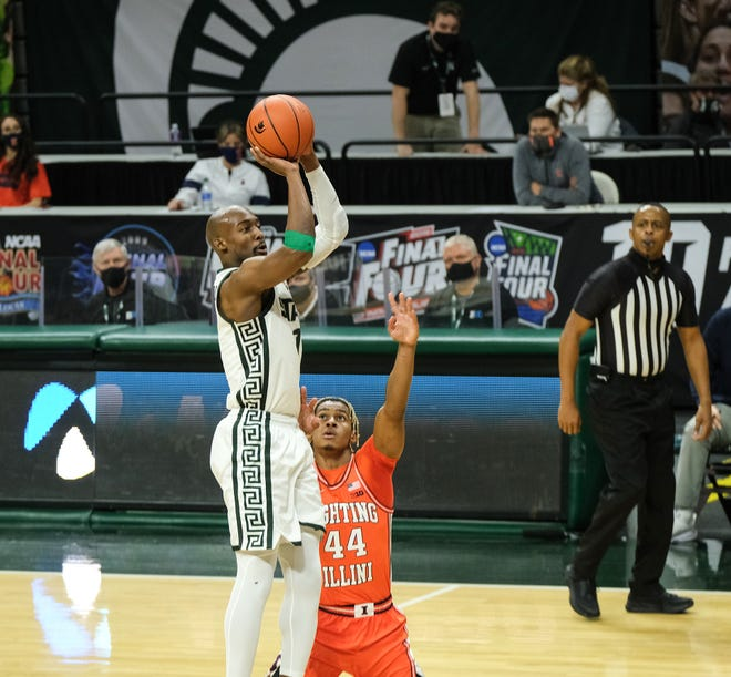 Michigan State's Joshua Langford (1) shoots over Illinois freshman Adam Miller (44) in first half action at the Breslin Center Tuesday Feb. 23, 2021.