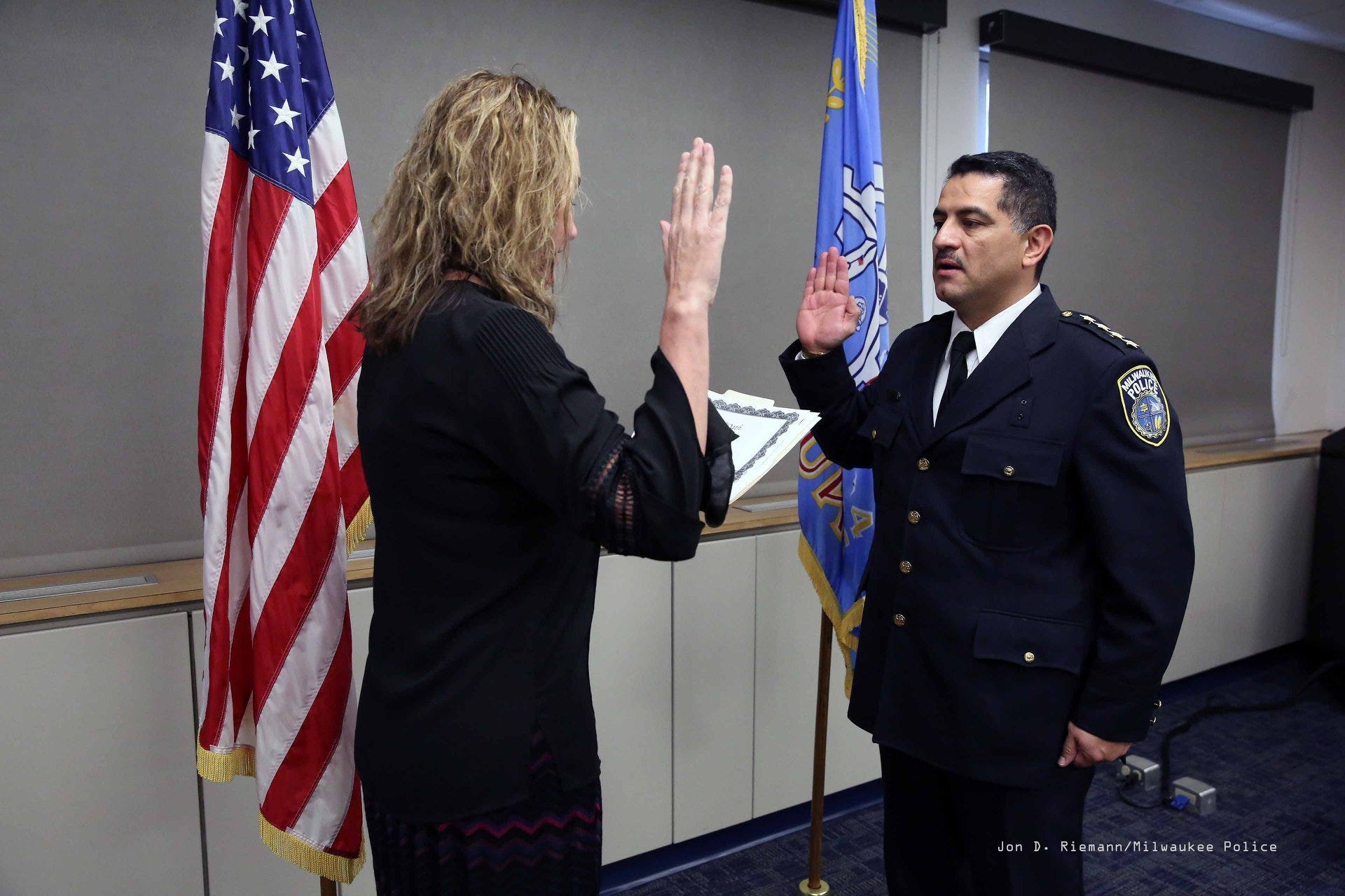 Alfonso Morales is sworn in as police chief by MaryNell Regan, executive director of the Fire and Police Commission, in this 2018 photo.