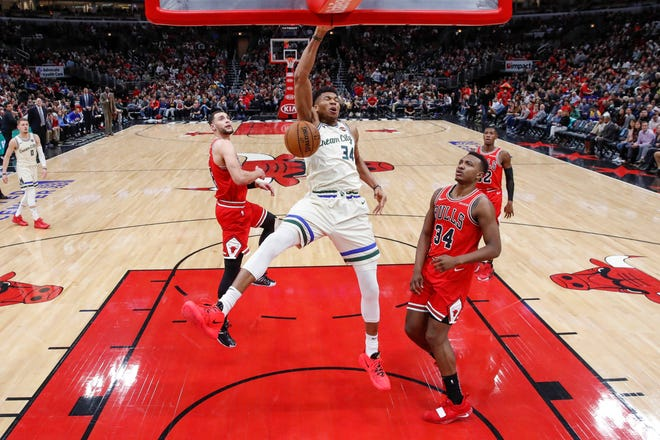 Bucks forward Giannis Antetokounmpo scores against the Bulls at the United Center on Dec. 30, 2019.