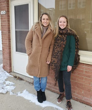 The Schneider sisters of West Allis, Samantha (left) and Skylar, both professional cyclists, are shown in front of the building that will house The Bread Pedalers, a new bakery and café they're hoping to open by late summer at 1436 S. 92nd St. in West Allis.