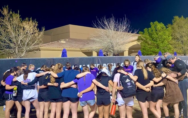 Northwest Christian girls' soccer huddle