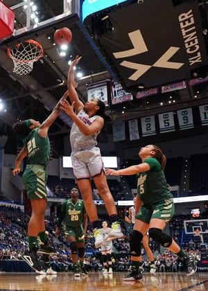 Forward Megan Walker was All-America first team as a junior at Connecticut in 2019-20. She recently was traded to the Phoenix Mercury along with Kia Nurse from the New York Liberty for two first-round draft picks.