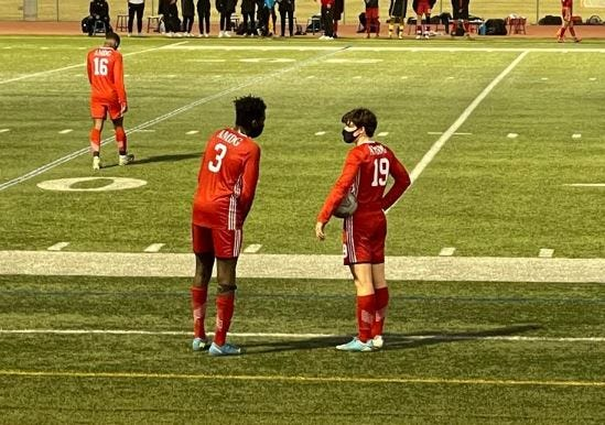 Tobi Babarinde (left) and Matthew White (right) discuss their options for the upcoming free kick for Brophy's boys soccer team, in a Feb. 19, 2021 game against Sandra Day O'Connor.