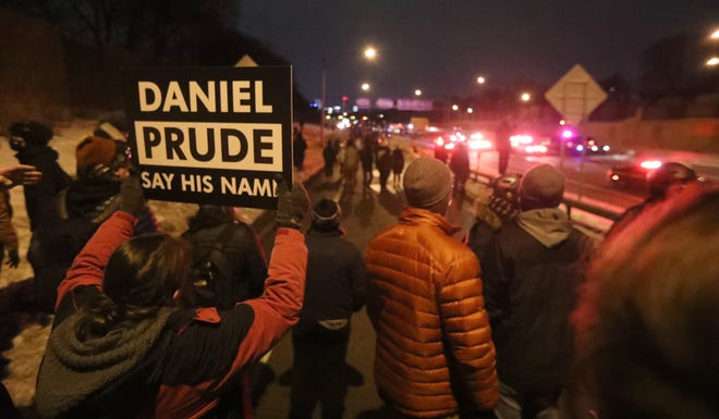 Protesters march to the Public Safety Building in February following an announcement by the state attorney general that the grand jury would not bring charges to any of the Rochester police officers involved in the Daniel Prude detainment that lead to his death last year.