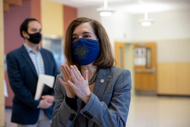 Gov. Kate Brown tours Kalapuya Elementary School to see what precautions are in place to keep students and faculty safe.