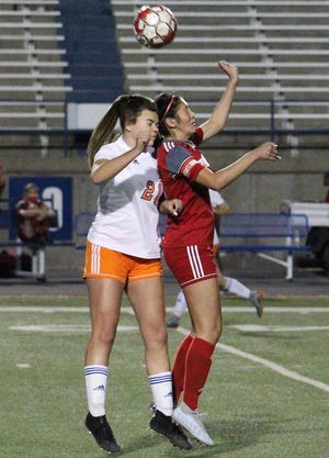 Odessa High's Cassandra Ramriez (right) and San Angelo Central's Riley Herbert (21) jump for a header during the first half of a District 2-6A game Tuesday at Ratliff Stadium.