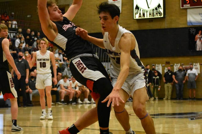 Hurricane and Pine View battle it out in the first round of the UHSAA playoffs. The Panthers escaped with a 50-47 win.