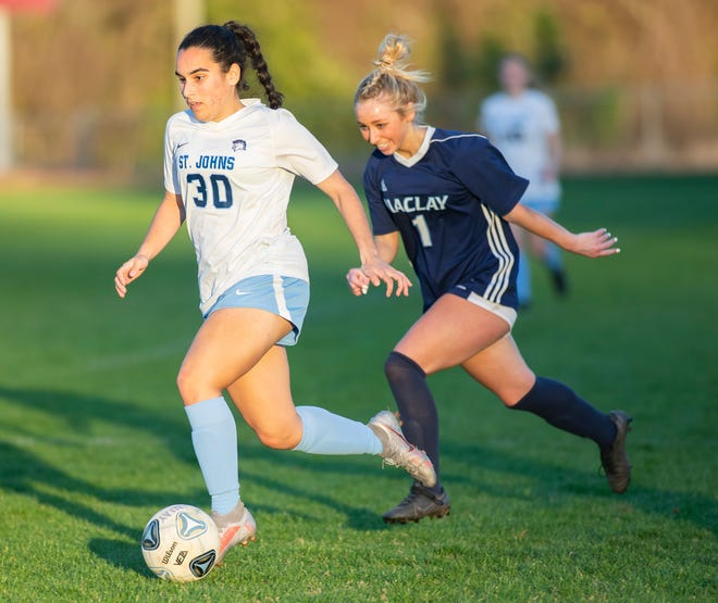St. Johns Country Day forward Julia Boaventura (30) dribbles as Maclay's Katelyn Dessi (1) chases after the ball in Tuesday's regional final. The Spartans are seeking their 10th consecutive FHSAA title.