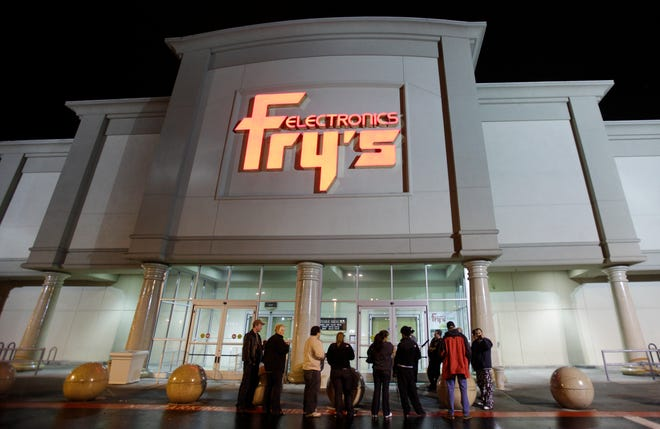 In this Oct. 21, 2009 file photo, a small crowd begins to gather outside a Fry's Electronics store in Renton, Wash.