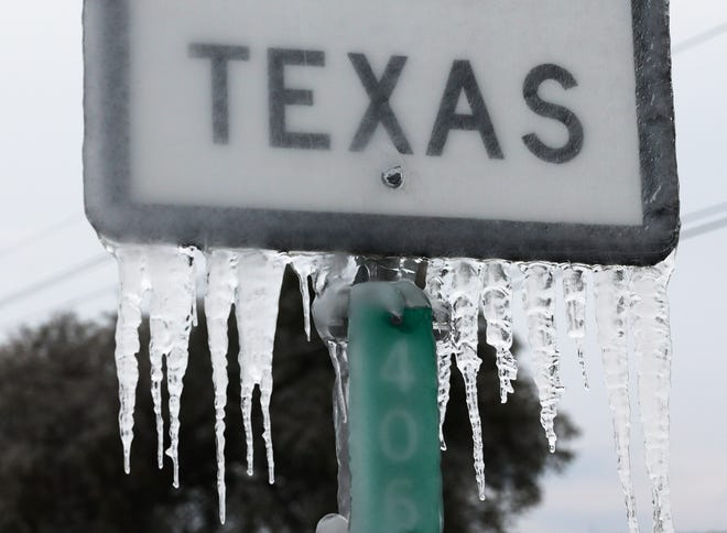 Icicles hang off the  State Highway 195 sign on Feb. 18 in Killeen, Texas. Winter storm Uri brought historic cold weather and power outages to Texas.